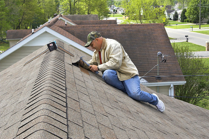 Man Working on Roof Repairs