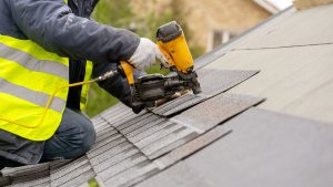 Roofer Replacing Roof Shingles