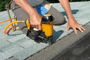 Roofer Repairing Shingles