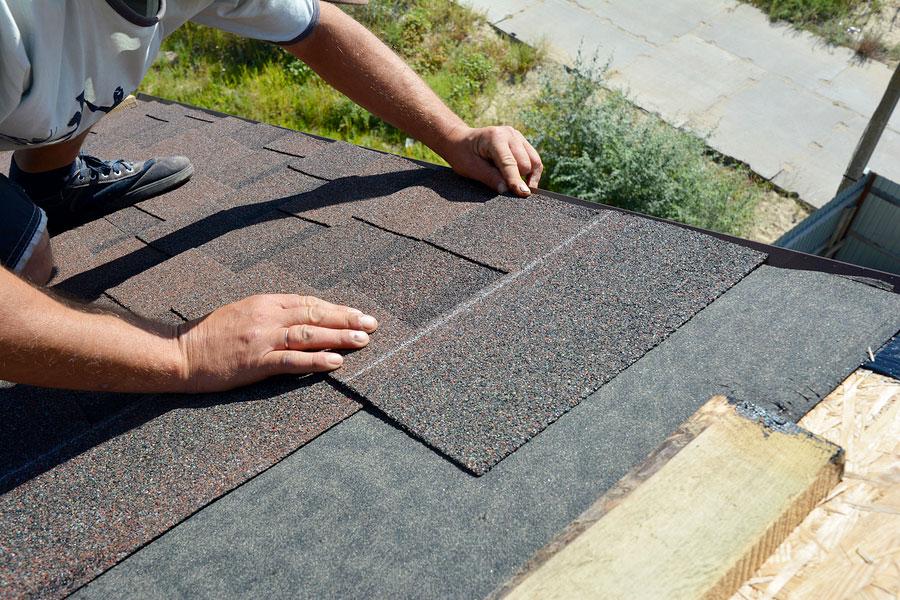 Roofer Installing Asphalt Shingle Roofing